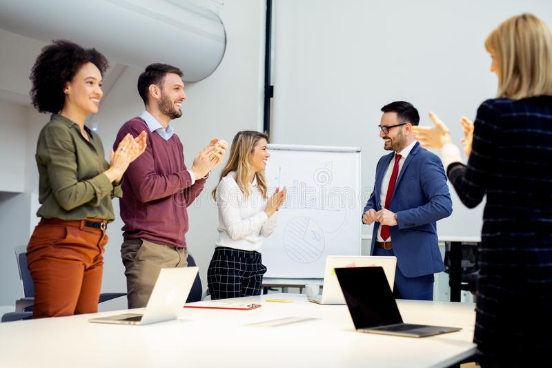 Young businessman successfully finished presenting his idea to t royalty free stock photos