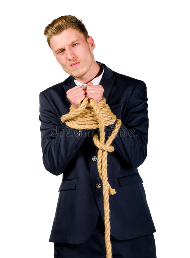 Young businessman in a suit tied up royalty free stock photo