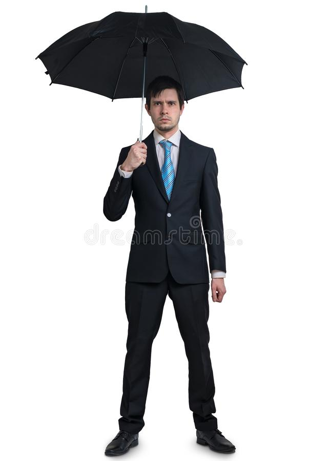 Young businessman in suit with umbrella isolated on white background. royalty free stock photo