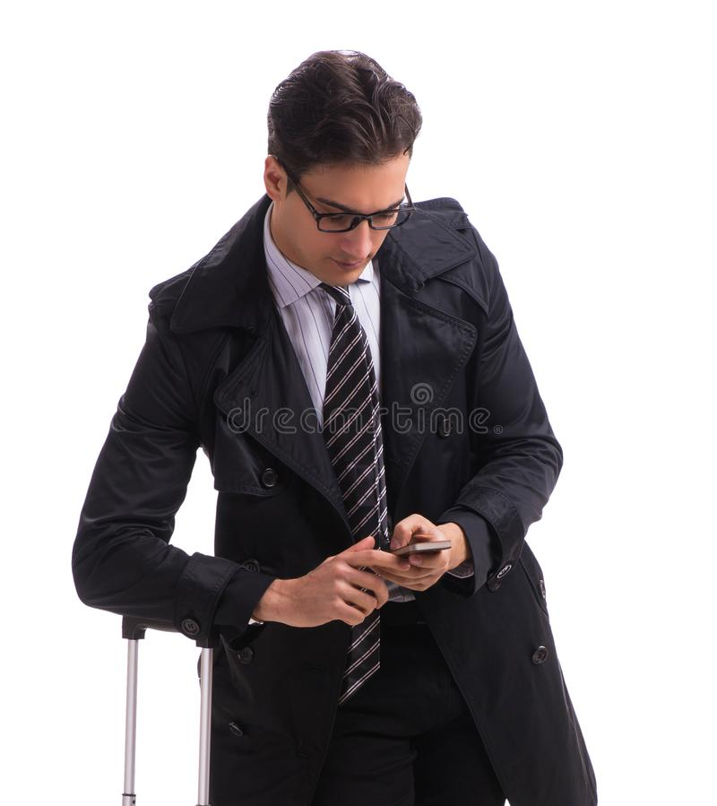 Young businessman with suitcase ready for business trip on white royalty free stock photos