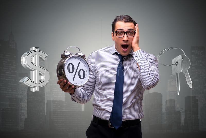 The young businessman surprised at high interest mortgage rates. Young businessman surprised at high interest mortgage rates stock image