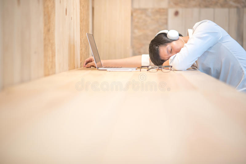 Young businessman take a nap in workspace stock photo