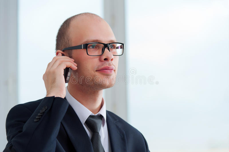 Young businessman talking by the phone royalty free stock photo