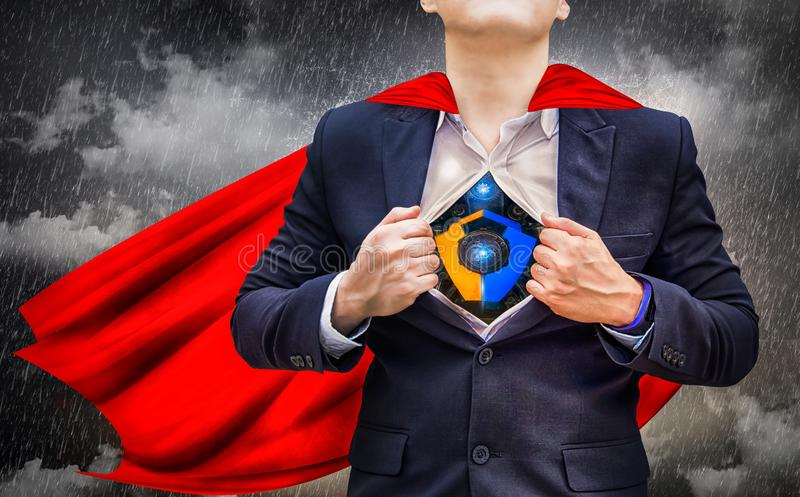 Young businessman tearing up his shirt, transforming himself into superhero,leadership concept,problem solving and personal royalty free stock image