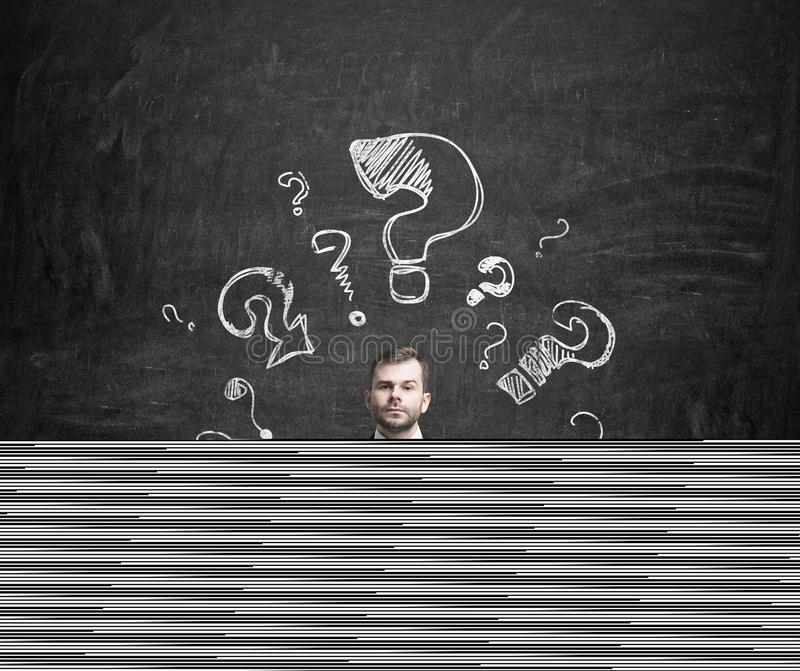 Young businessman is thinking about complicated questions. royalty free stock photos