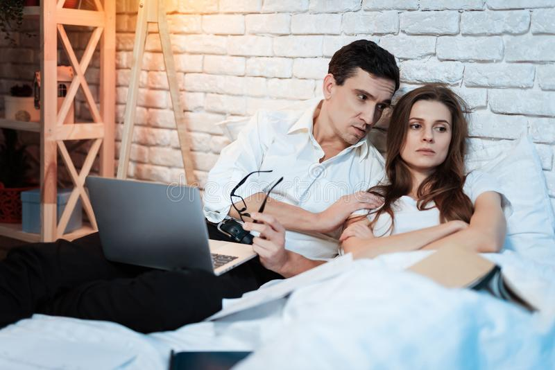 Young businessman tries to console woman. Irritated woman is upset. Young couple is arguing. stock image