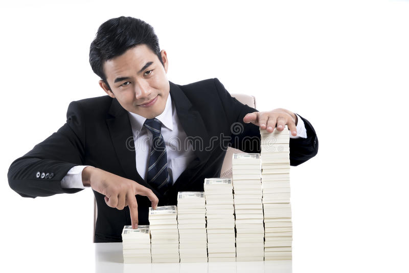 Young businessman used finger acting like walking up the stairs stock photo