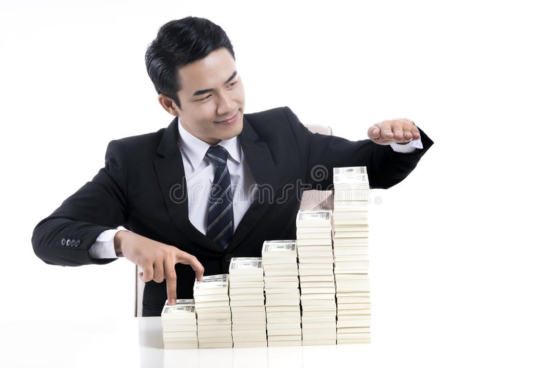 Young businessman used finger acting like walking up the stairs stock photography