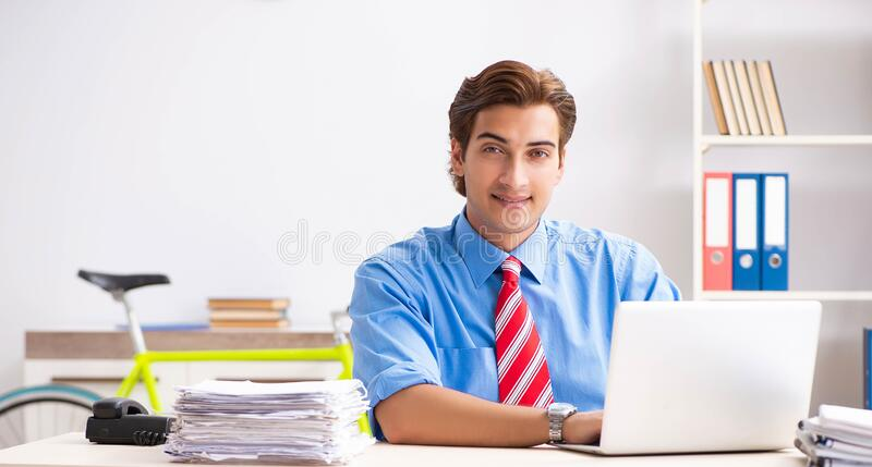 Young businessman using bike to commute to the office. The young businessman using bike to commute to the office royalty free stock photos