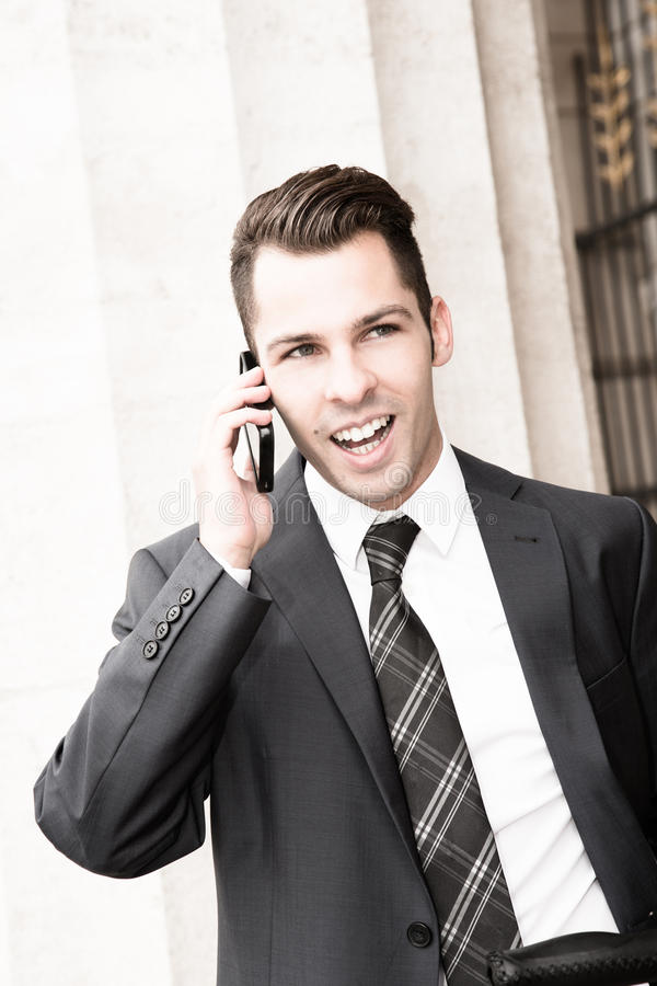 Download Young Businessman Using A Mobile Phone Stock Photos - Image: 25959313