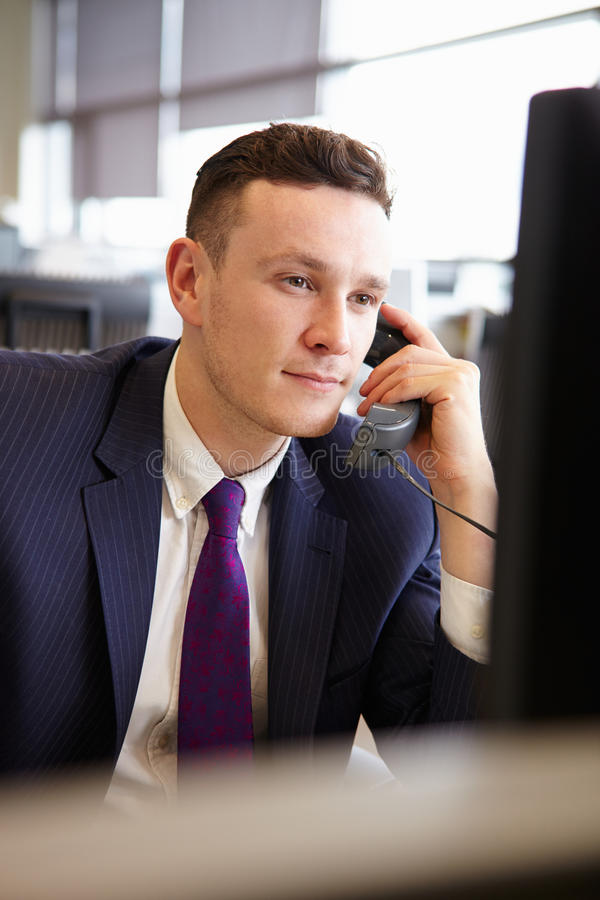 Young businessman using phone, vertical portrait stock photos