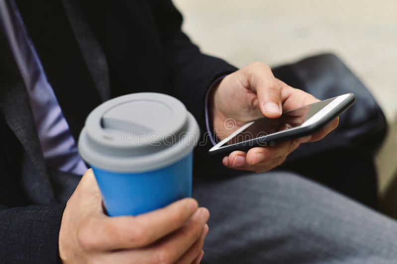 Young businessman using a smartphone stock image