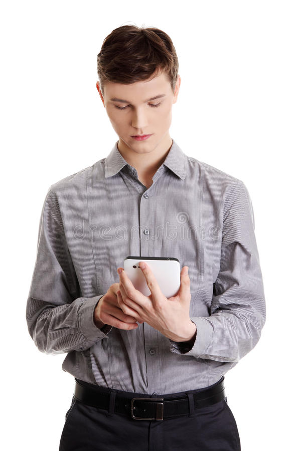 Download Young Businessman Using Tablet Computer Stock Image - Image: 22280741