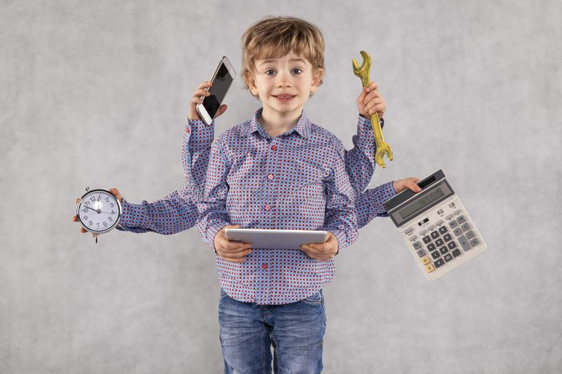 Young businessman is very multitasking person, octopus concept, stock photography