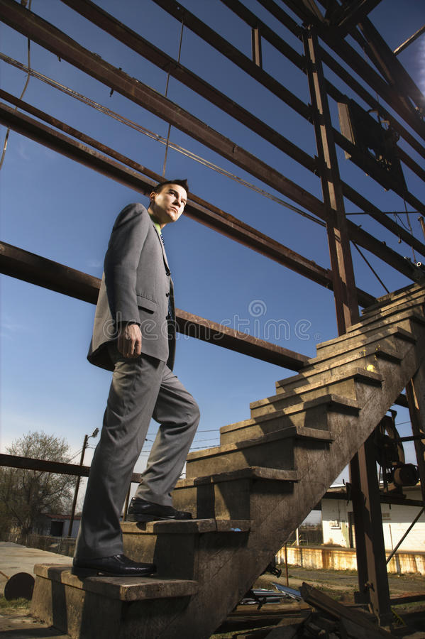 Young Businessman Walking Up Stairs royalty free stock photo