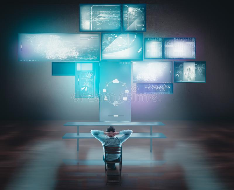 Businessman watching touch screens and computers on desk. royalty free stock photos