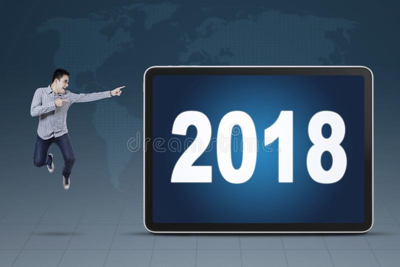 Young businessman pointing at numbers 2018 royalty free stock images