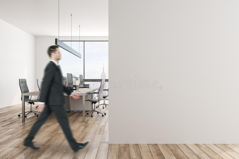 Young businessman in white office stock photo