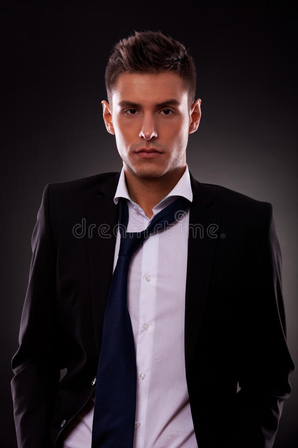 Free Young Businessman With Loose Tie Stock Photo - 26398650
