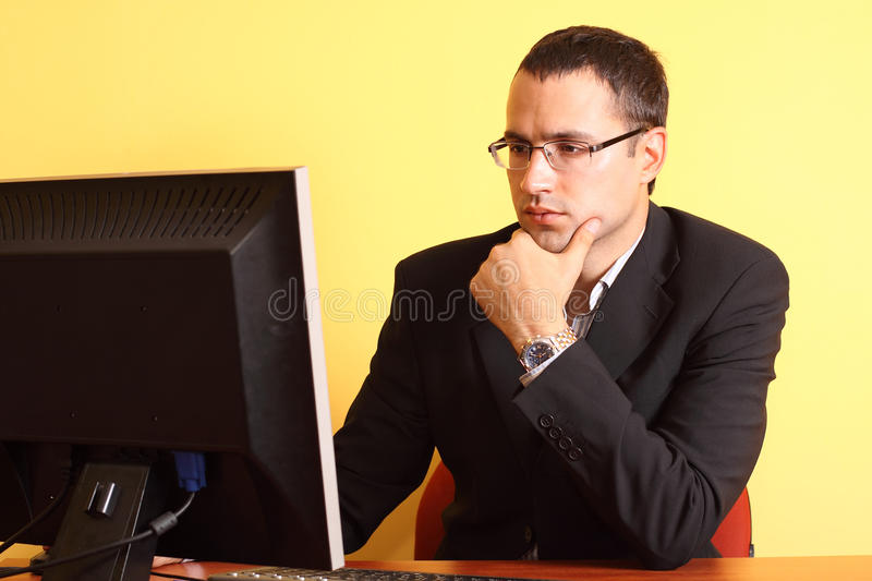 Young businessman working on computer at office stock photo