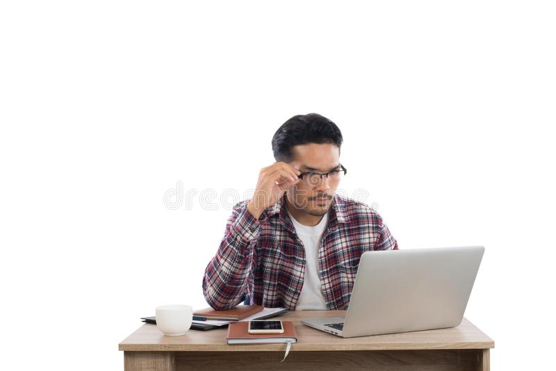 Young businessman working on laptop isolated on white background stock photography