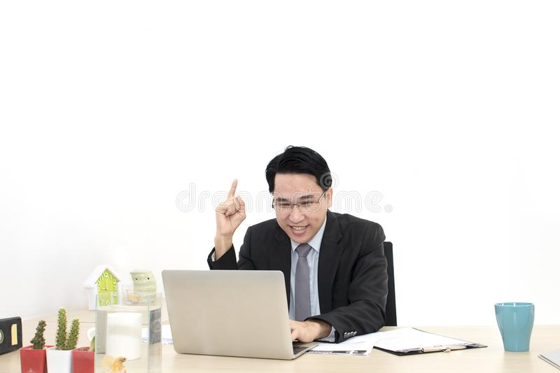 Young businessman working with laptop and office Supplies. stock photo