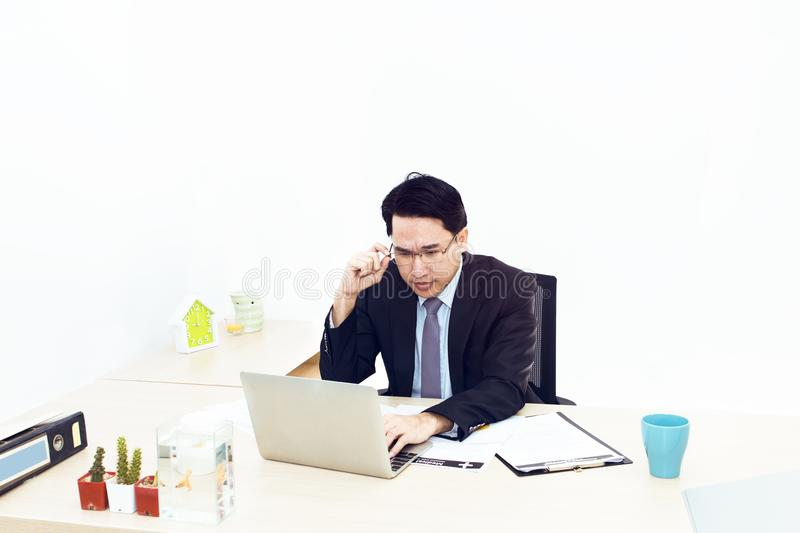 Young businessman working with laptop and office Supplies. royalty free stock images