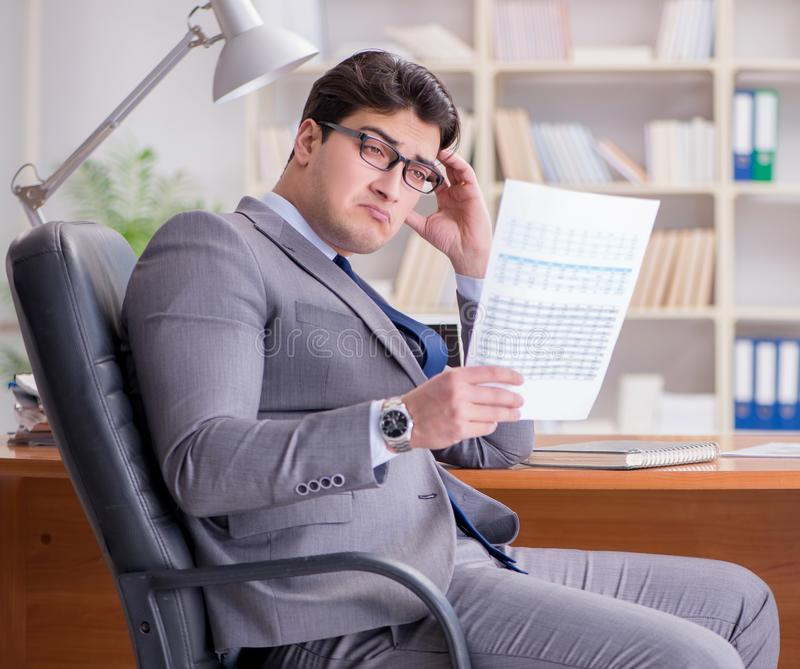 Young businessman working in the office royalty free stock images