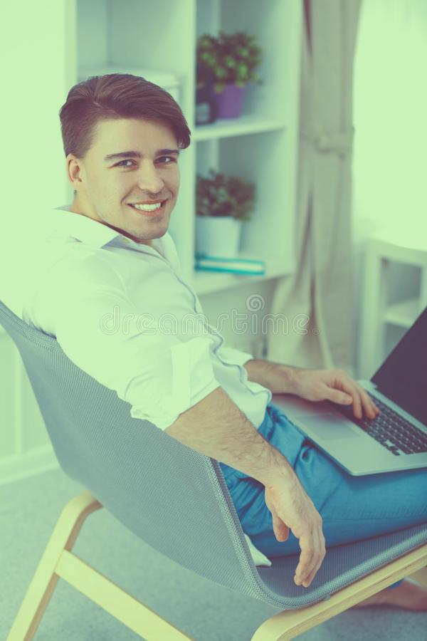Young businessman working in office, sitting at desk stock images