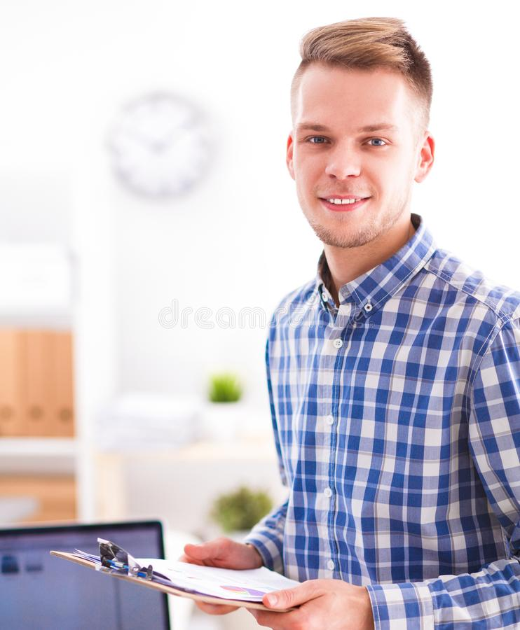 Young businessman working in office, sitting at desk. Young businessman working in office , sitting at desk royalty free stock photos