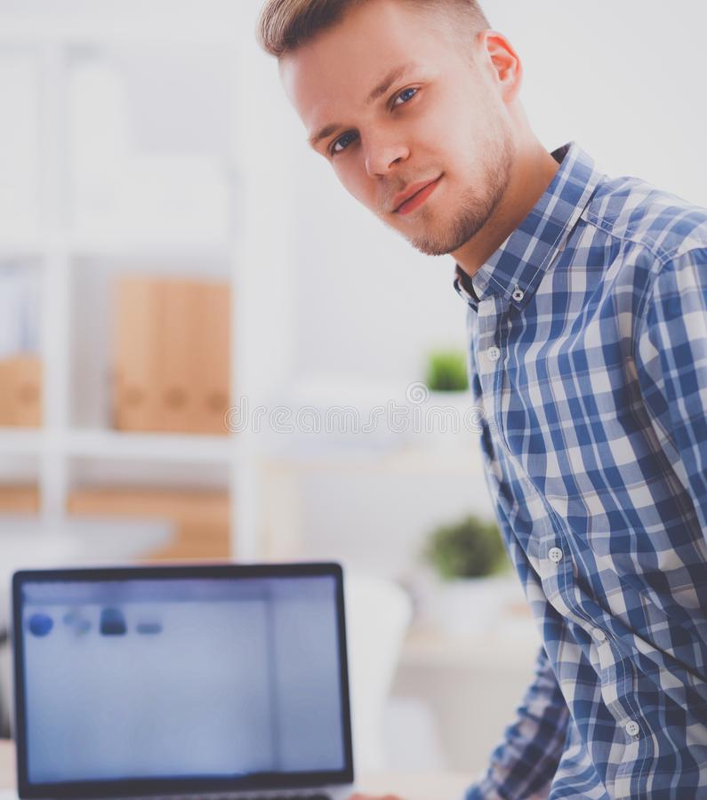 Young businessman working in office, sitting at desk. Isolated royalty free stock images