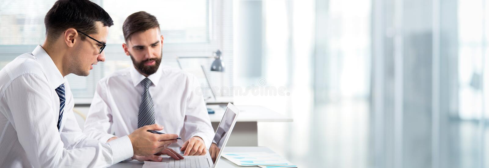 Young businessman working in an office stock photo