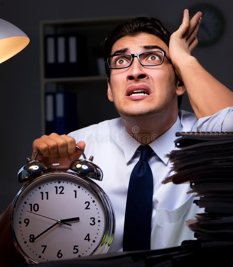Young businessman working overtime late in office. The young businessman working overtime late in office royalty free stock photography