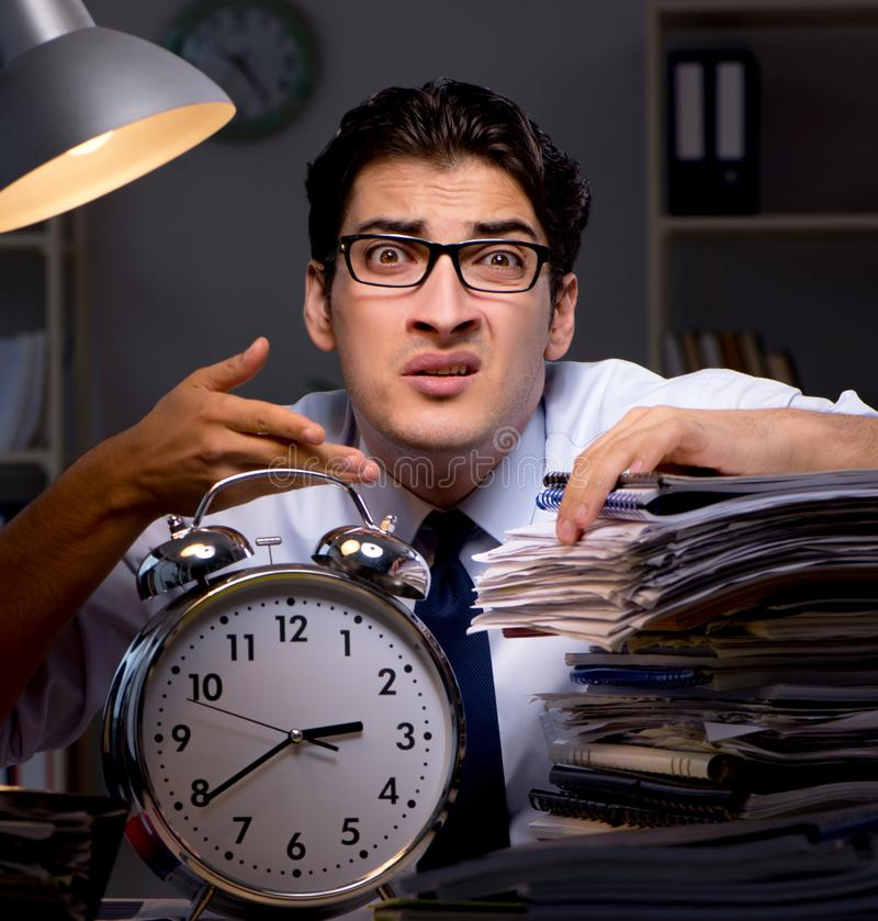 Young businessman working overtime late in office. The young businessman working overtime late in office royalty free stock photo