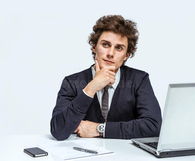 Young Businessman at the workplace working with computer royalty free stock photos