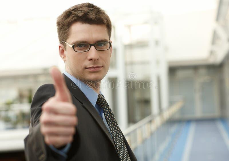 Young businessmanoffice smile thumb u stock image