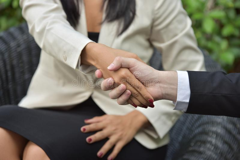Business Collaboration.Young businessmen shake hands When the news is good. Young businessmen congratulate There is a raised hand and smiling. Get the good news stock photos