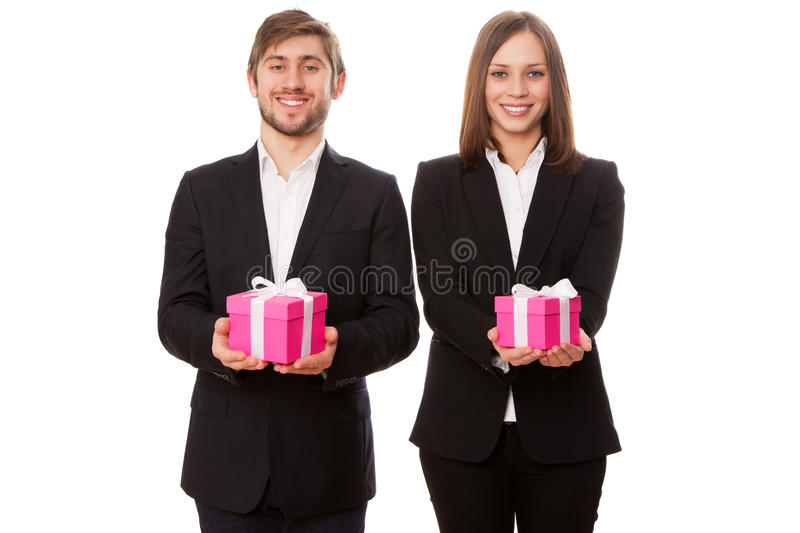 Young businessmen holding gift boxes.  stock photo