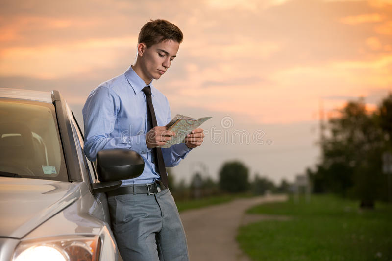 Young businessmen with roadmap. Next car royalty free stock photography