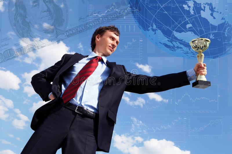 Young businessnman with award stock photos