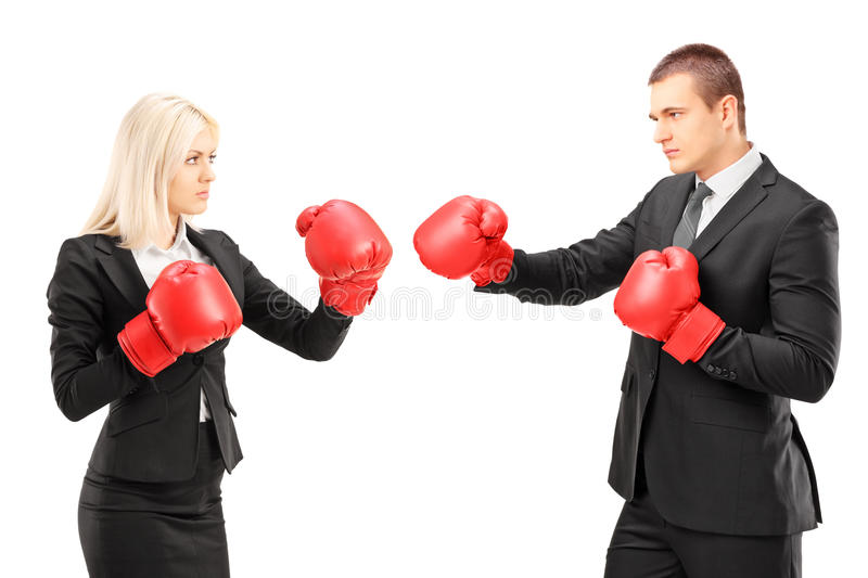 Young businesspeople with boxing gloves having a fight