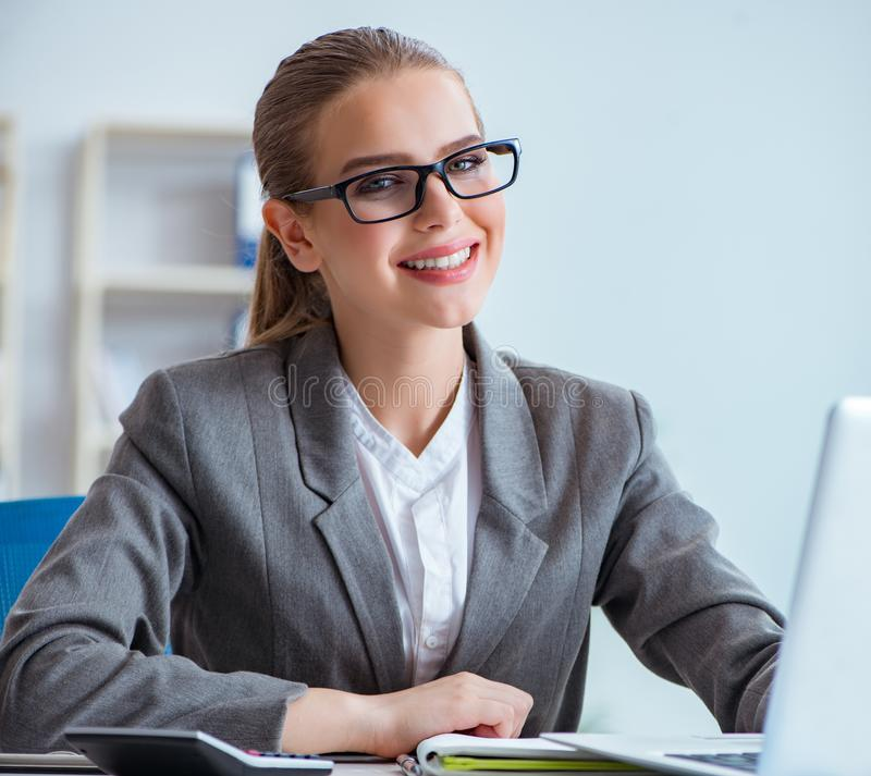 Young businesswoman accountant working in the office stock images