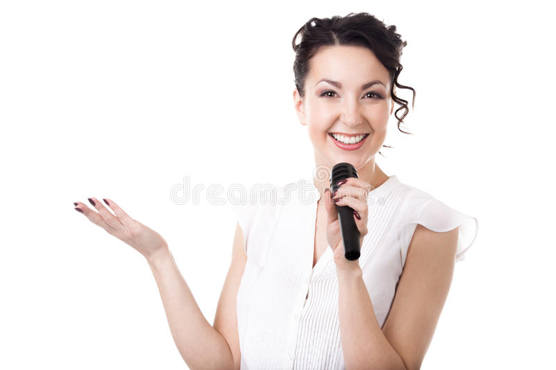 Young businesswoman announcer with microphone on white background. Presentation, public speech, conference, broadcasting, advertising. Cheerful young stock image