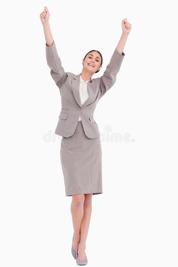 Young businesswoman with arms raised stock images
