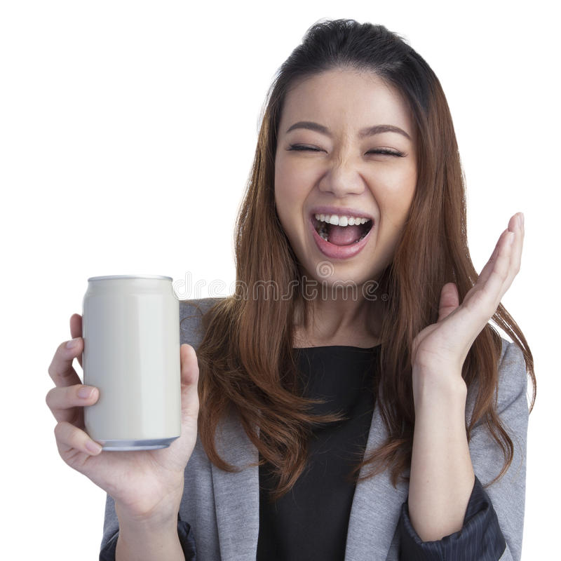 Young businesswoman attractive cheerful for a can of soft drink. Full length young business woman pretty beautiful attractive cheerful presenting grey a can of royalty free stock photo