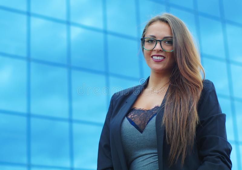 Young businesswoman blue building background successful professional stock image