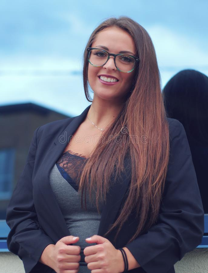 Young woman blue skyscraper glasses success attractive office confident person royalty free stock image