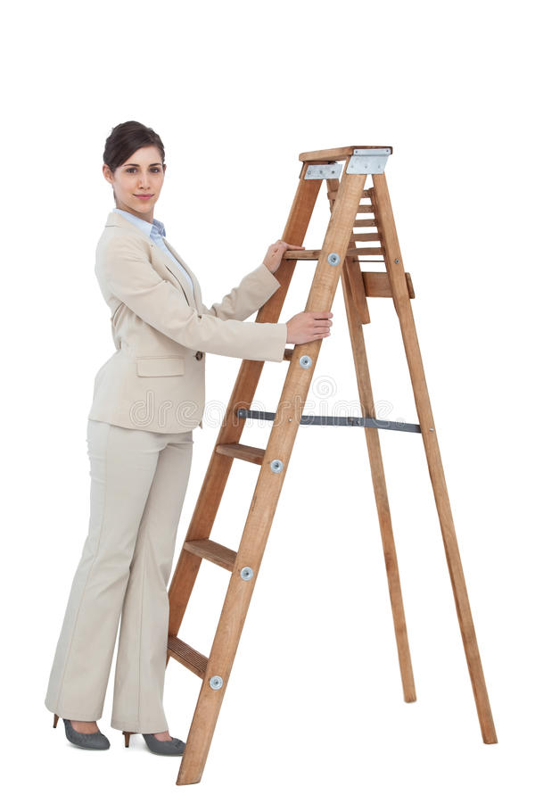 Young Businesswoman At The Bottom Of The Career Ladder Stock Image