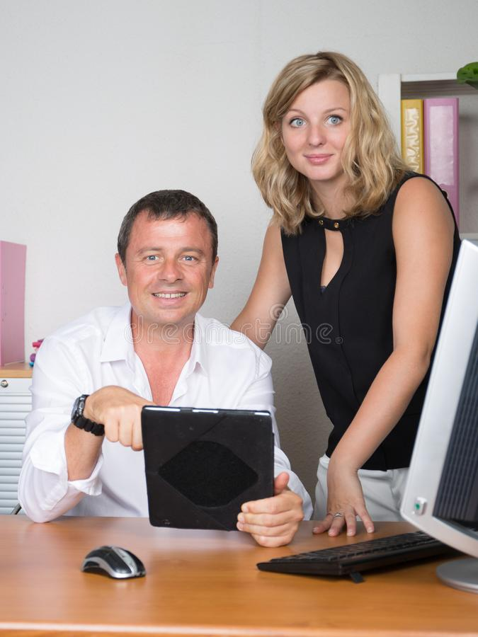 businesswoman and businessman working in office with tablet royalty free stock photography