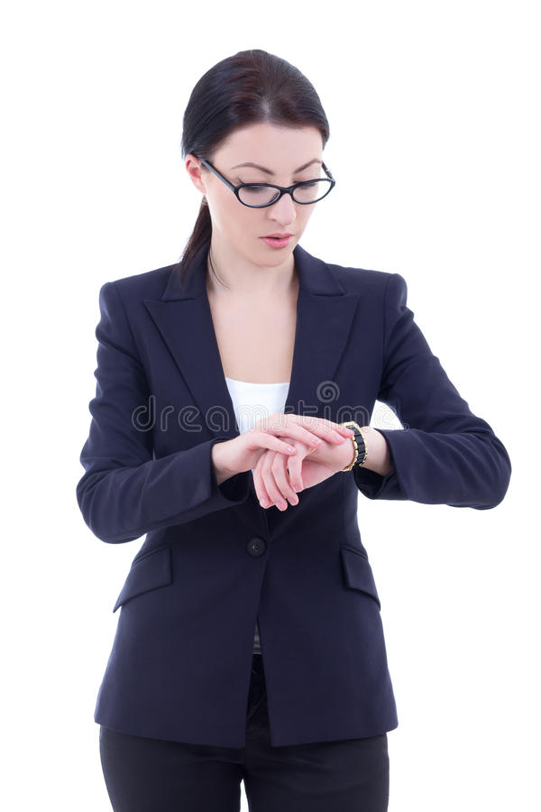 Young businesswoman checks time on her wrist watch isolated on w. Hite background stock images